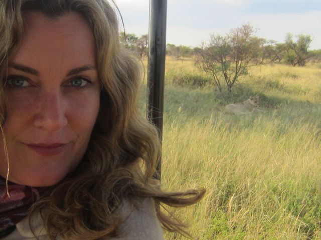 You may notice the lioness behind me in the tall grass.
