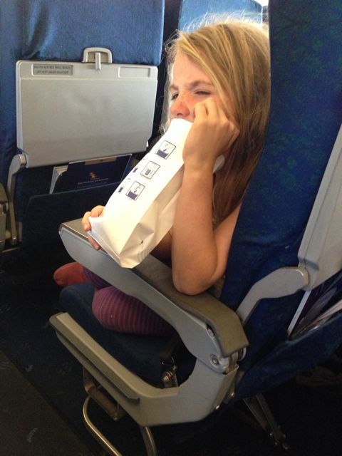 Willa barfing on the plane from Johannesburg.
