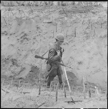 lossy-page1-220px-Vietnam....Marines_of_Company_H,_2nd_Battalion,_4th_Regiment,_walk_through_a_punji-staked_gully._-_NARA_-_532439.tif